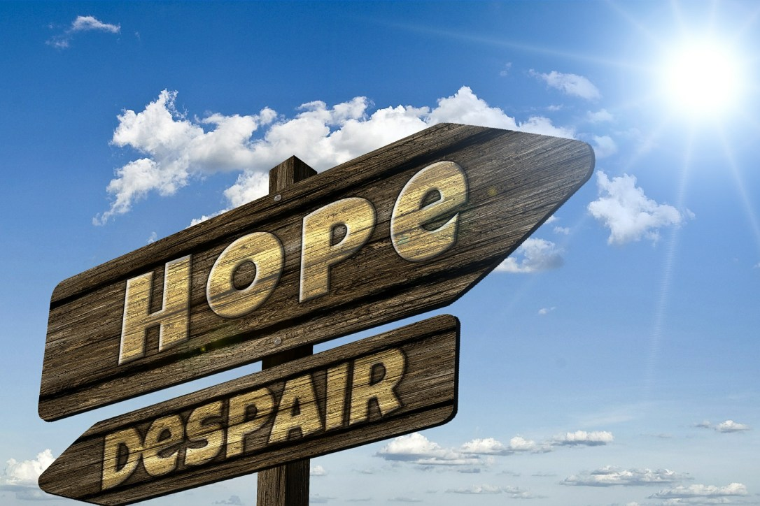 A sign of hope pointing forward and despair pointing behind. We can have hope for our lost loved ones when we trust in God's great mercy.