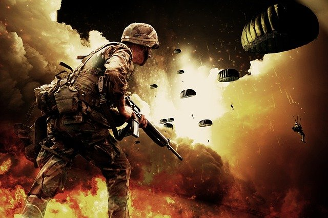 This is a picture of a soldier with a machine gun facing explosions and parachutes. God trains our hands for war.