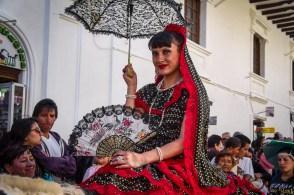 Woman in costume at the Pase del Niño parade in Cuenca, Ecuador