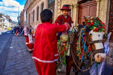 Child ridding a horse at the Pase del Niño parade in Cuenca, Ec