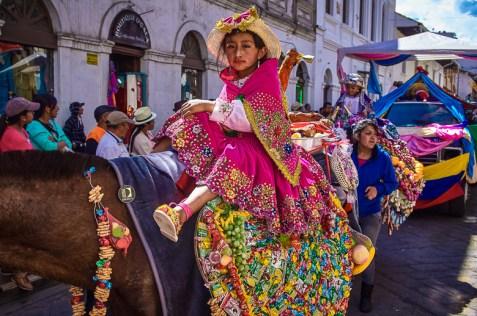 Girl ridding a horse at the Pase del Niño parade in Cuenca, Ecu