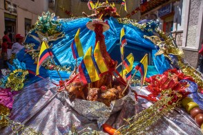 A bizarre chicken offering at the Pase del Niño parade in Cuenc