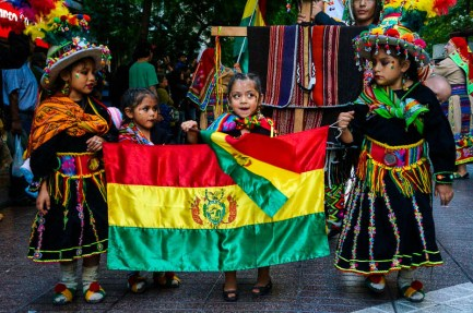 Girls carrying flag at Fiesta de la Chakana in Santiago de Chile