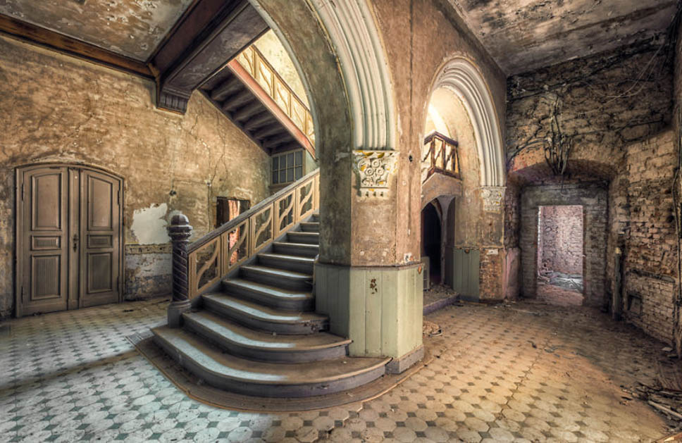 old abandoned staircase with pillar and arch