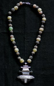 Tuareg ebony silver amulet with powder glass and terre cuite beads