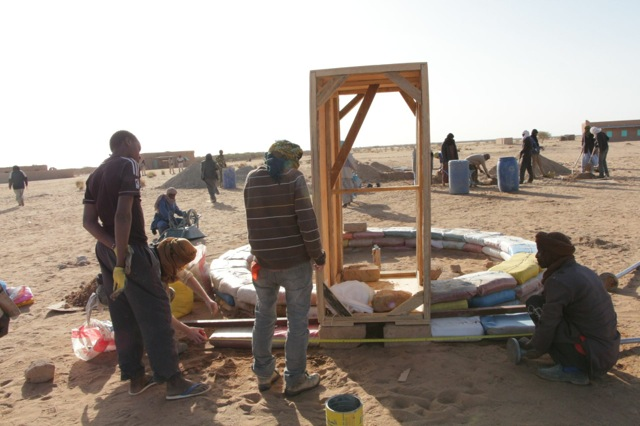 The door form was then set.  We realized that these wood forms would be expensive for nomads so the system was adjusted on the third dome