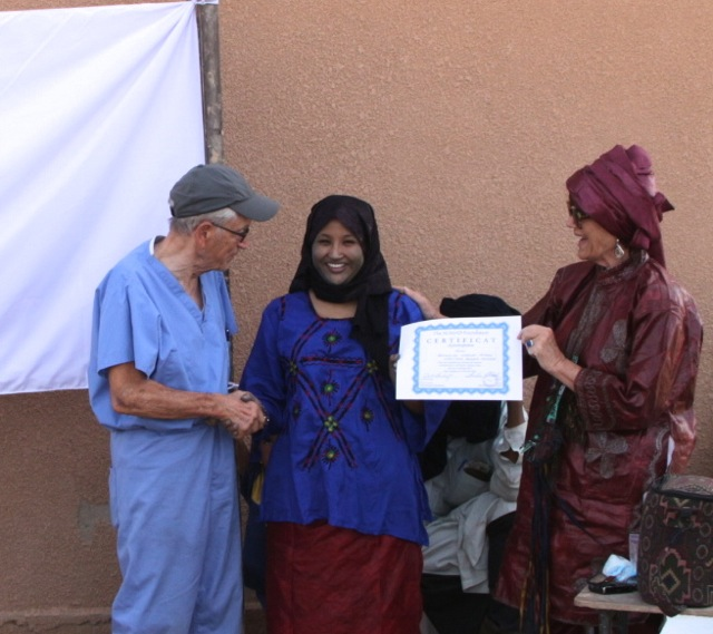Achicha receives the certificate naming her Niger director of the matrone (assistant midwife) program.