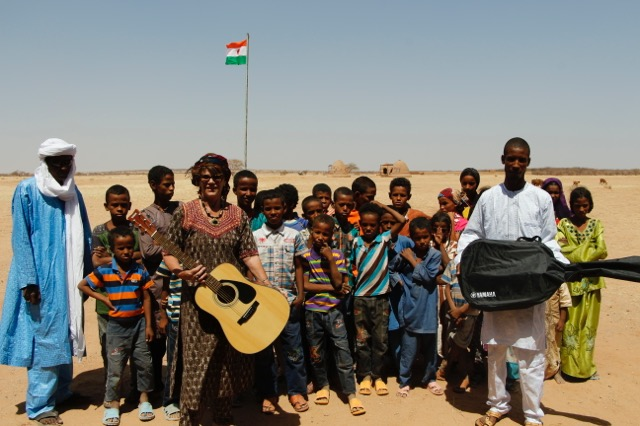 Alhassane, music director with Leslie and Assadek presenting the new guitars to the students of Tamesna school.