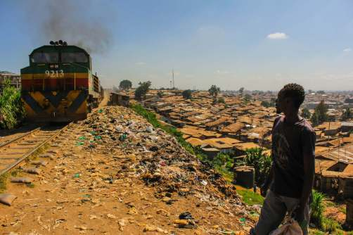 The Daily Train Runs Thought the Center of the Slum