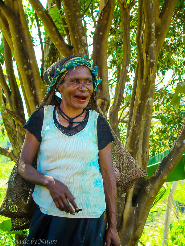 Papuan Woman Walking to Market