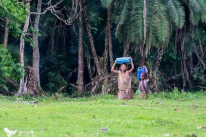 Children Carrying Water, Bigodi Wetlands, Uganda