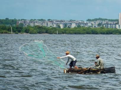 Men Fishing in Cuba on a Make-shift Boat