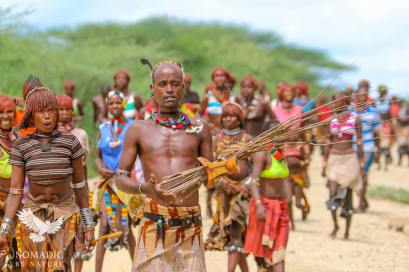 A Hamar Maza Man Arrives to the Bull Jumping Ceremony with Switches, Ethiopia