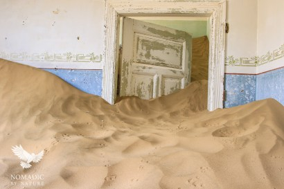 A Sand Dune Flowing like Water out of a Room, Kolmanskop Ghost Town, Namibia
