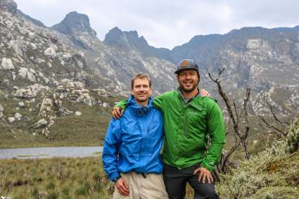 Posing for a Picture in Front of Lake Kopel, Rwenzori Mountains
