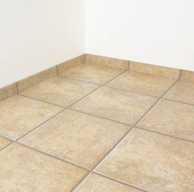 Tile Skirting vs Wood Baseboard Molding | Nomadic Decorator