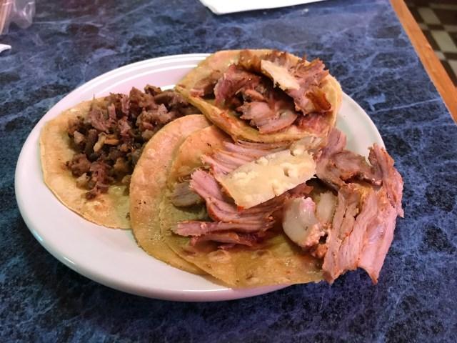 """Suadero (beef brisket) and Al Pastor (marinated pork) Tacos from """"El Rey de Suadero"""" Taqueria in Mexico City. That's a pineapple slice atop each Al Pastor taco."""