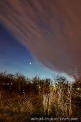 Venus about to be overtaken by cloud cover shortly after sunset; off camera flash used to light the foreground grasses