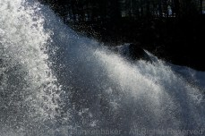 Freezing water in time with a fast shutter instead of cold temperatures