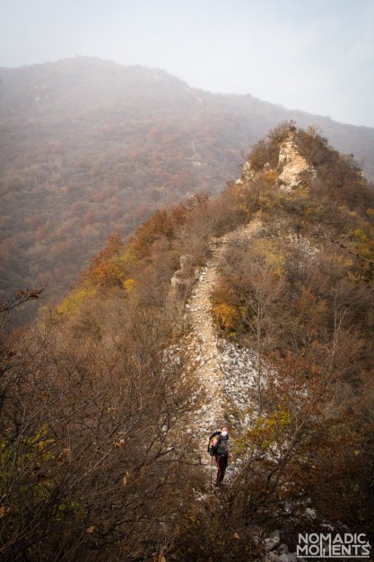 A hiker along the path where the Great Wall once stood.