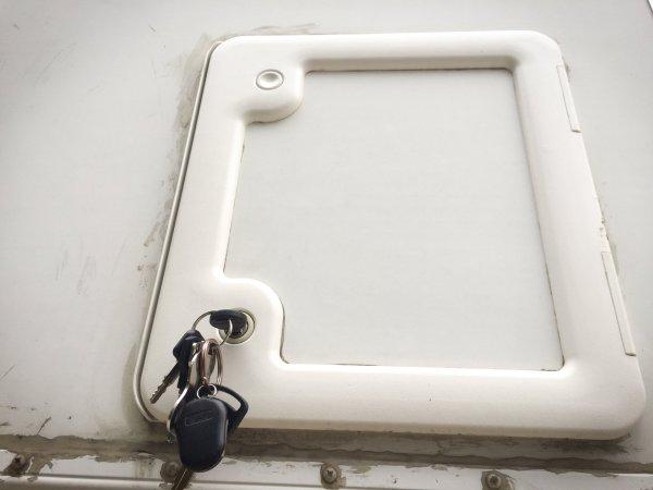 The cassette toilet door hatch with keys.