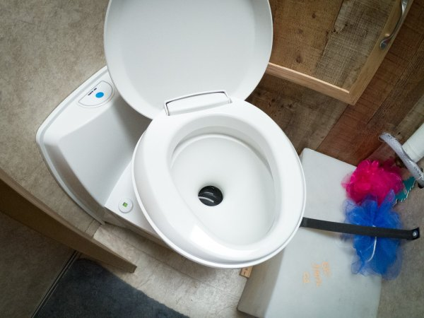 The Thetford C223-CS toilet bowl set at an odd angle.