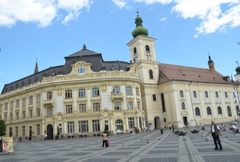 Banca Agricola (left) and Holy Trinity Catholic Church (right) in Sibiu, Romania