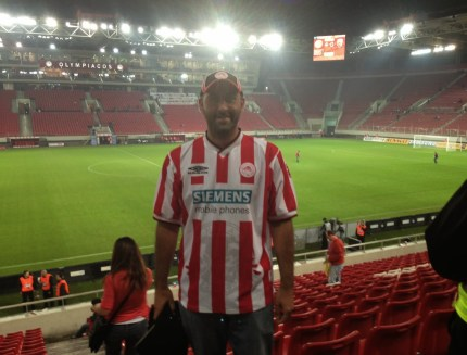 A happy Olympiakos fan at Olympiakos vs PAOK at Karaiskaki Stadium, Piraeus, Greece