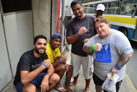 Zezinho passing out wristbands at Rocinha favela, Rio de Janeiro, Brazil