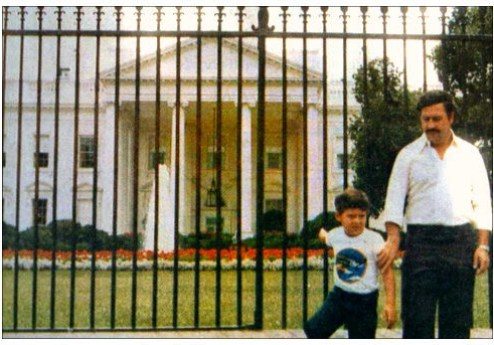 Escobar with his son at the White House while a member of Colombia's congress.