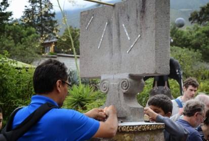 Balancing an egg at Museo Intiñan at Mitad del Mundo in Ecuador