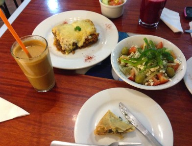 Moussaka, Greek salad, spanakopita, and frappé at Suvlaki in La Mariscal, Quito, Ecuador