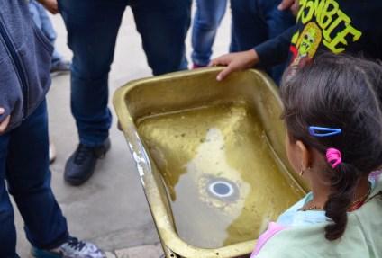 Draining water on both sides of the Equator at Museo Intiñan at Mitad del Mundo in Ecuador