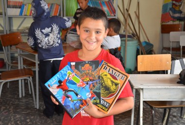 A student with his new notebooks in Belén de Umbría, Risaralda, Colombia