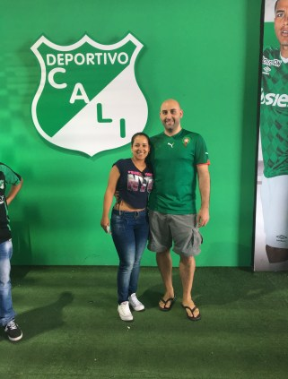 Marisol and I in front of the Deportivo Cali logo at Estadio Deportivo Cali in Palmira, Valle del Cauca, Colombia