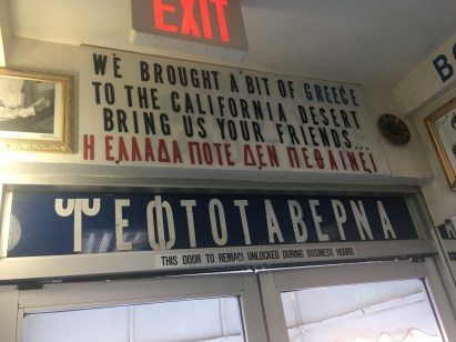 Above the exit at the Mad Greek Café in Baker, California