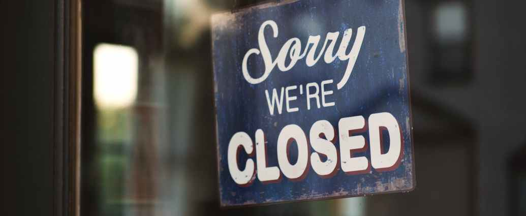 blue and white sorry we re closed wooden signage