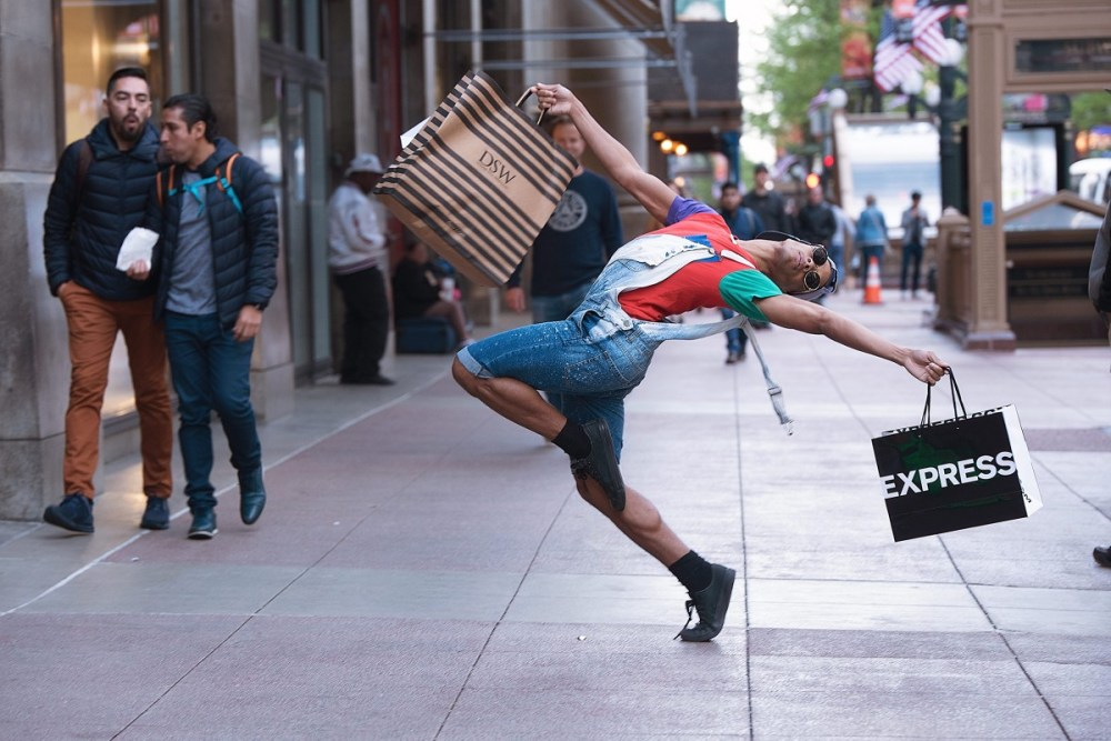Joe Musiel dancer doing ordinary things shopping on State Street