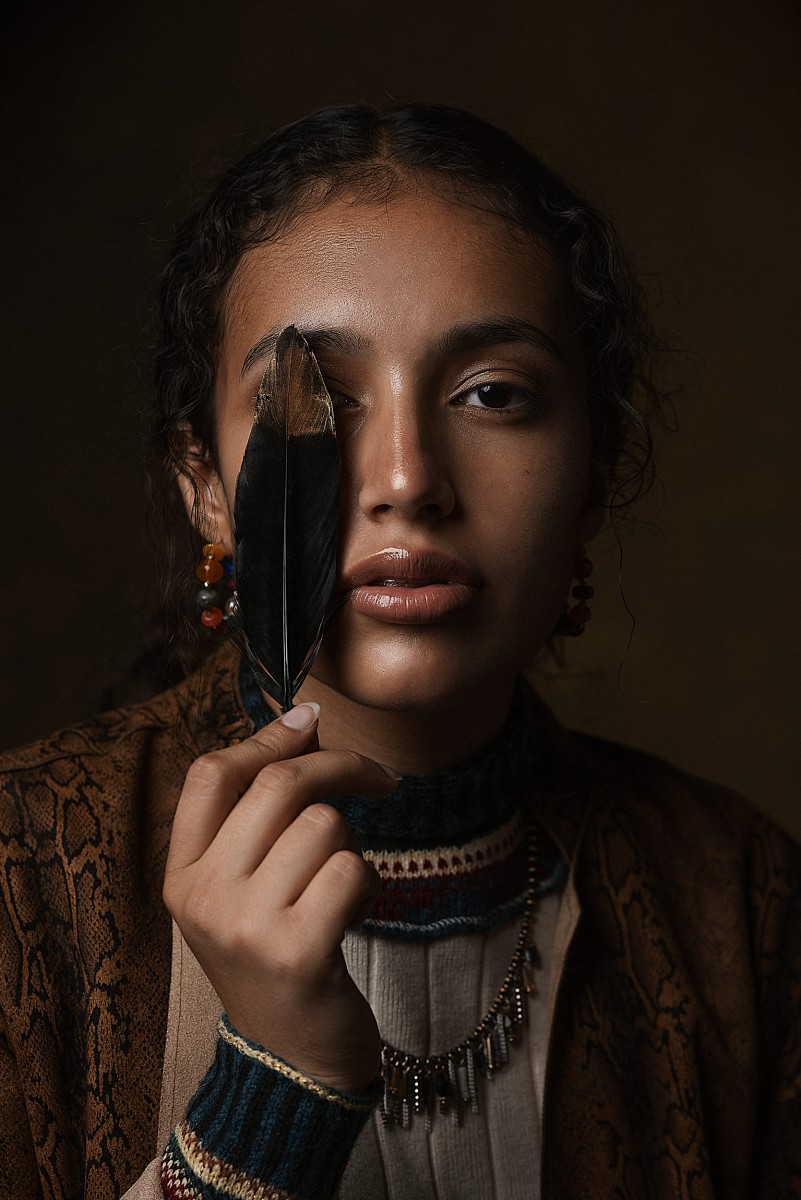 Nomee Studio Closeup Beauty Portrait of Genesis Martinez and a feather
