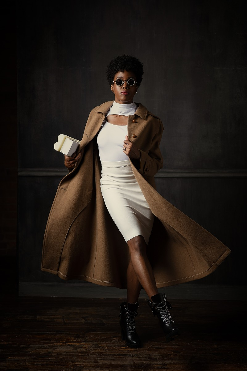Paige Fraser Burberry Trench with white skirt and shirt black boots