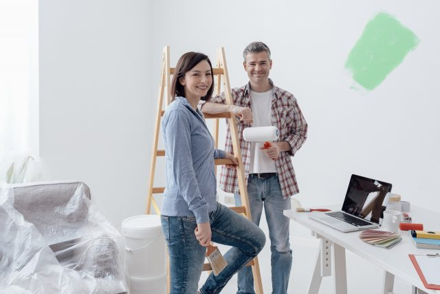 Home improvements - Couple Painting Their House
