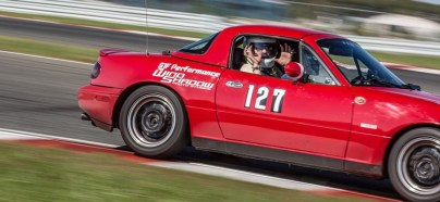 red-miata-on-track-with-instructor