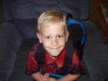 His very first day of kindergarten, slicked back hair and Spiderman backpack. This picture just does things to my heart!