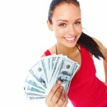 Cheerful young lady holding cash and smiling