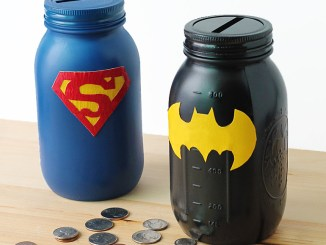 From: http://www.firefliesandmudpies.com/2014/09/14/mason-jar-superhero-banks/