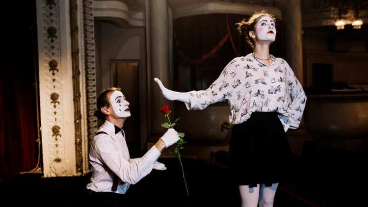 Mimes performing on stage.