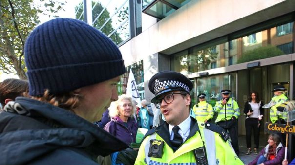 A member of the police discusses section 14 of the Public Order Act with protesters outside the Department for Environment, Food and Rural Affairs , Marsham Street, during an Extinction Rebellion (XR) protest in Westminster, London.