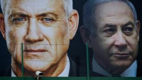 File photo shows election poster in Ramat Gan, Israel, featuring Benny Gantz (left) and Benjamin Netanyahu (right) (17 February 2020) AFP