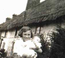 Mrs. Smith at the front of the cottages