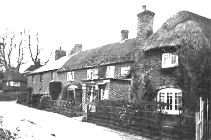 The Easole Stores opposite the Baptist Chapel with the now demolished Shakespear Cottage on the right.